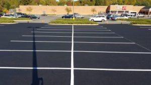 commercial parking lot sealcoating service -- XSealer Asphalt Maintenance