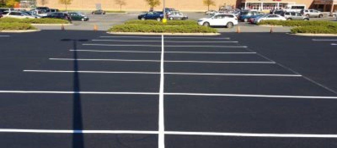 commercial parking lot sealcoating service -- XSealer Asphalt Maintenance